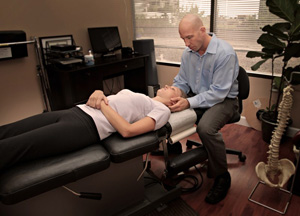 Dr. Terry Dickson treating a patient in North Vancouver